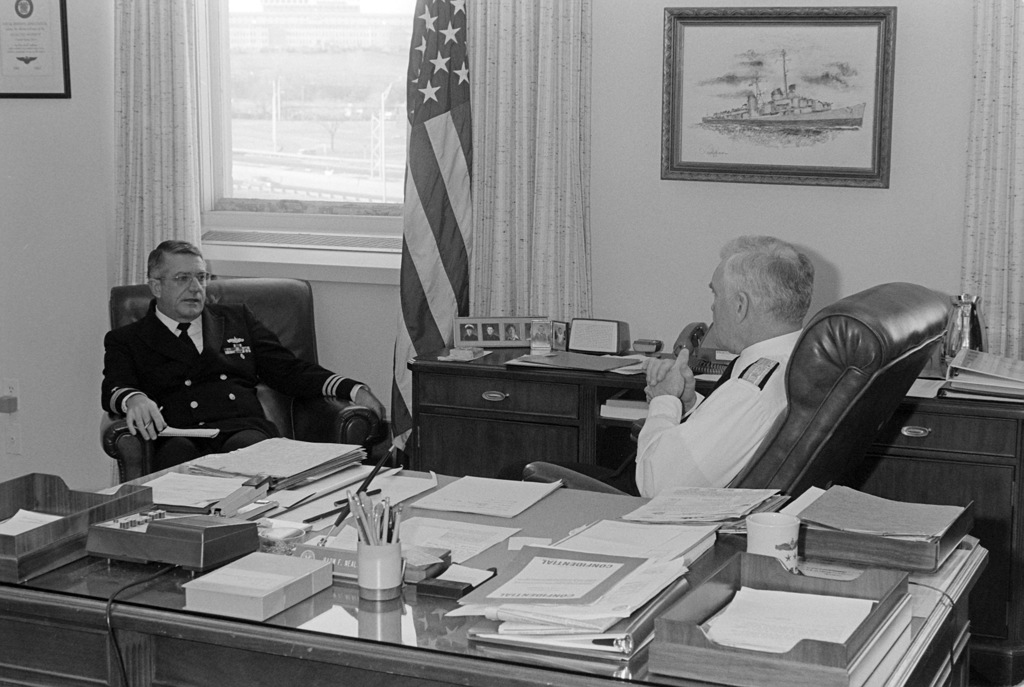 Rear Admiral (RADM) (upper half) F. Neale Smith, USNR, chief of naval reserve, talks with an officer in his office at the Pentagon