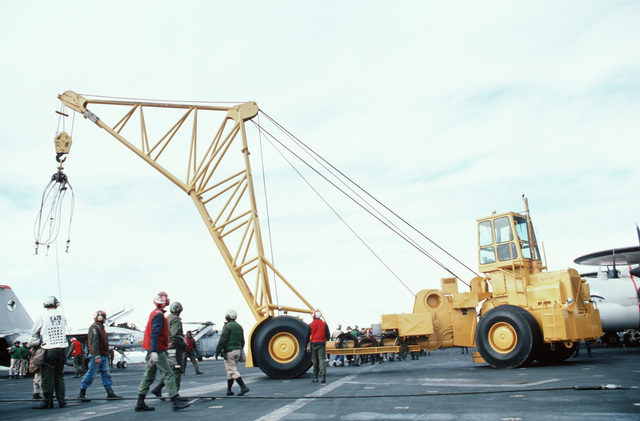 An NP-50 aircraft crane is maneuvered on the flight deck during a general quarters drill aboard the aircraft carrier USS JOHN F. KENNEDY (CV 67)
