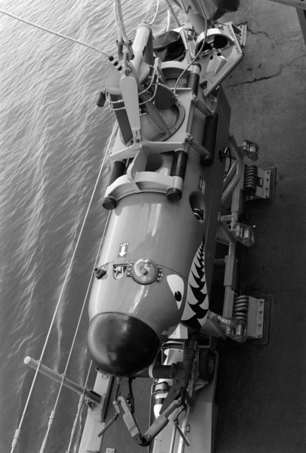 An overhead view of the Mine Neutralization System (MNS) vehicle which is cable-controlled by the mine countermeasures ship USS AVENGER (MCM 1).  The submersible vehicle is on board the AVENGER as the vessel arrives in home port at Naval Base, Charleston.  The AVENGER, assigned to Mine Squadron 2, is the first of eight ships currently being built by the Navy to replace the older open ocean minesweepers (MSOs) constructed in the 1950s