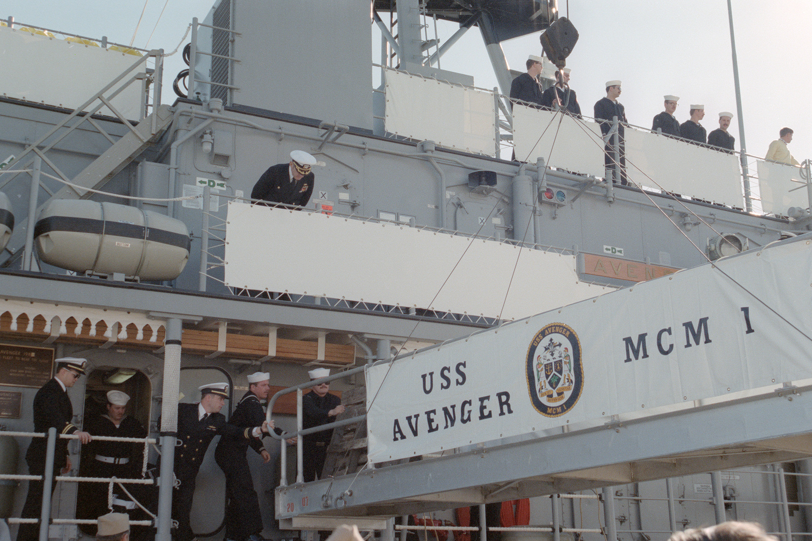 Crew members secure the gangplank for family members to board the mine countermeasures ship USS AVENGER (MCM 1) as the vessel arrives in home port at Naval Base, Charleston.  The AVENGER, assigned to Mine Squadron 2, is the first of eight ships currently being built by the Navy to replace the older open ocean minesweepers (MSOs) constructed in the 1950s