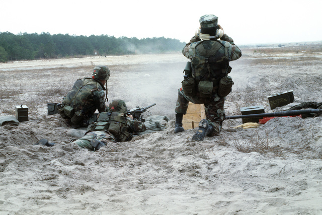 Marines fire an M2 .50-caliber machine gun at beachfront targets during a combined arms training exercise near Fort Story