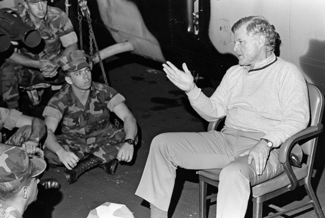 Senator Edward Kennedy, Democrat-Massachusetts, talks with Marines aboard the amphibious assault ship USS OKINAWA (LPH 3) on Christmas Eve while the ship patrol the Perisan Gulf