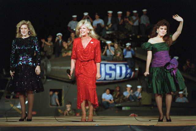 Singer Connie Stevens, center, and her daughters Tricia Lee and Jo Lee Fisher perform during the Bob Hope United Services Organization (USO) show aboard the amphibious assault ship USS OKINAWA (LPH 3)