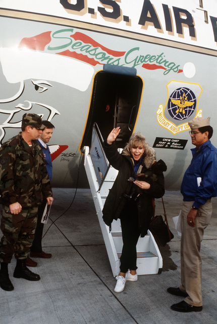 Actress Barbara Eden departs after a stopover on base.  Eden had been performing in Bob Hope's Christmas Show in the Persian Gulf