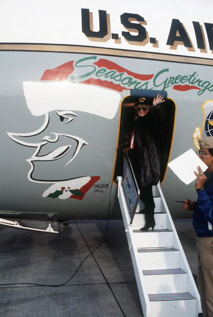 Actress Connie Stevens departs after a stopover on base.  Stevens has been performing in Bob Hope's Christmas Show in the Persian Gulf