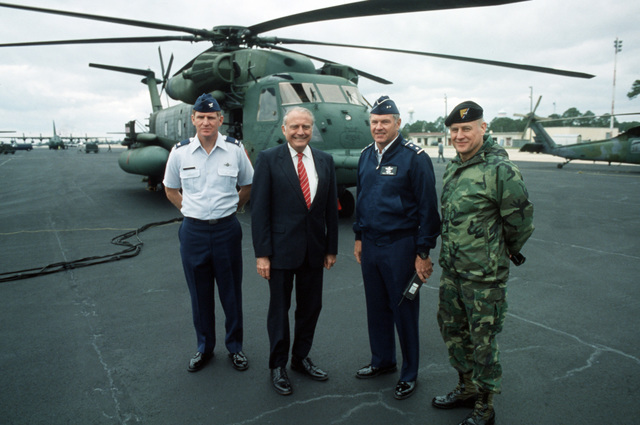 VIPs stand together on the flight line in front of one of the latest additions to the Air Force's aircraft inventory,  the MH-53J Enhanced Pave Low III helicopter.  They are, left to right:  Colonel (COL) Dale E. Stovall, commander, 1ST Special Operations Squadron; Secretary of the Army John O. Marsh Jr.; Major General (MGEN) Robert B. Patterson, commander 23rd Air Force; and MGEN (selectee) Wayne A. Downing, director of the Washington, District of Columbia (DC) office of Special Operations Command