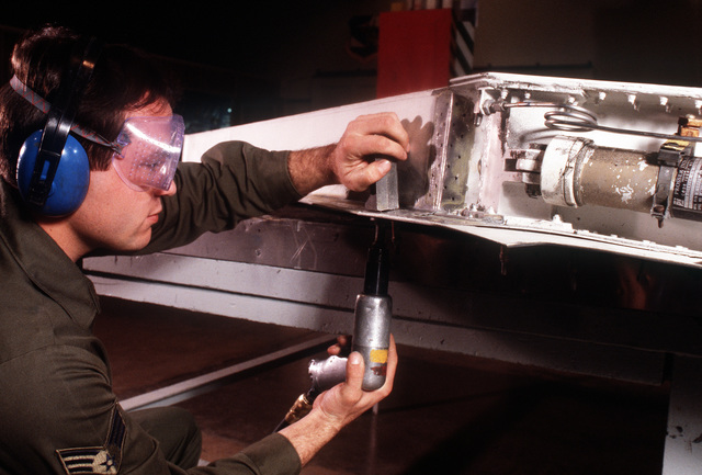 A maintenance specialist installs a patch plate on a 509th Bombardment Wing F-111 aircraft. Aircraft inspections and repairs are made quickly and more efficiently due to the implementation of the Strategic Air Command's Readiness Oriented Logistics System