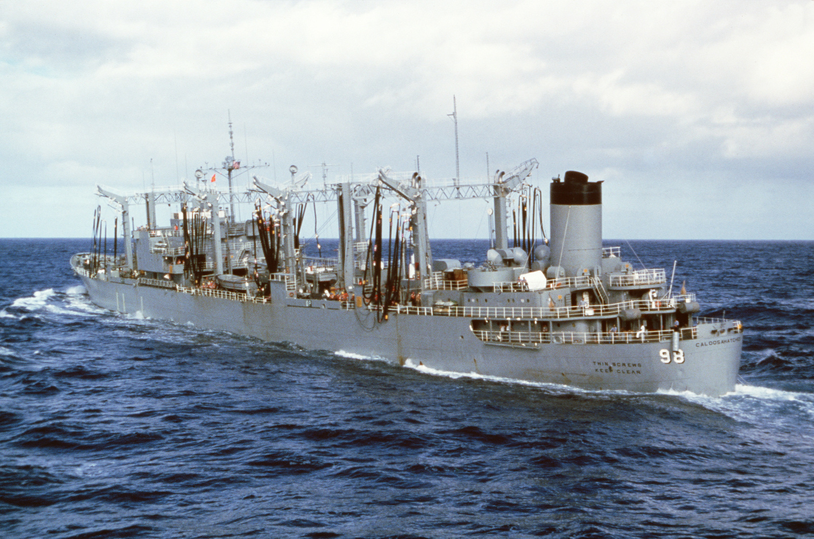 A port quarter view of the oiler USS CALOOSAHATCHEE (AO 98
