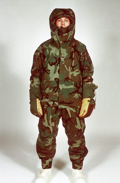 A soldier models the camouflage printed moisture vapor permeable laminate outer garments worn over other elements of the extended cold weather clothing system (ECWCS). The ECWCS has been designed by the U.S. Army Natick Research, Development and Engineering Center to provide environmental protection from minus 40 to 60 degrees above zero, easy adjustability of clothing layers, and a new principle of moisture management. Fifth in a series of five views