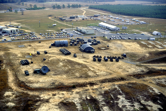 An aerial view of the 507th Tactical Control Wing field headquarters during Exercise CORONET STROKE'88.  The objectives of the exercise are to establish and maintain a netted tactical air control system, set up a composite air surveillance system, and control sorties flown by various aircraft to test their combat capabilities under difficult field conditions.  CORONET STROKE'88 represents the largest single-service netting of tactical communications in Air Force history