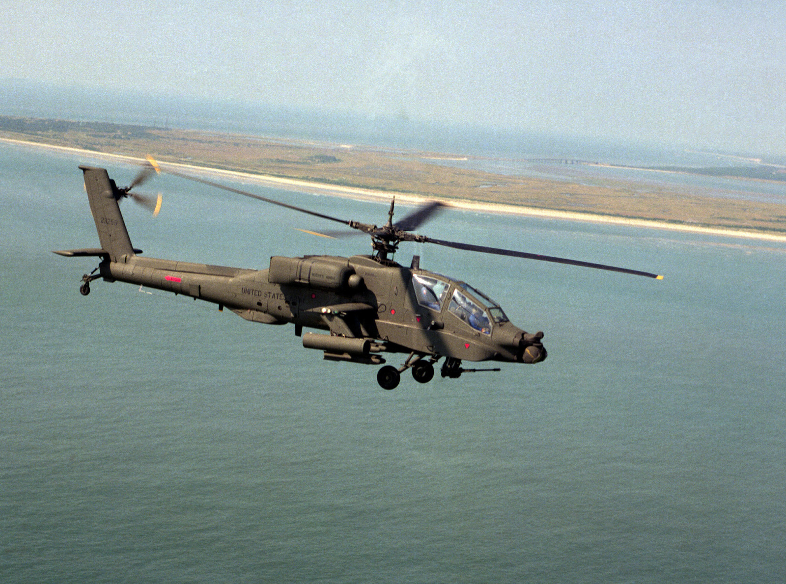 An air-to-air right side view of an AH-64A Apache helicopter - U.S. National Archives Public Domain Image