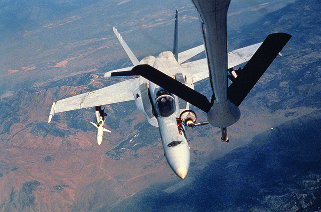 An F/A-18 Hornet aircraft armed with an AGM-88 High-speed Anti-Radiation Missile (HARM) is refueled in flight during Exercise Gallant Eagle '88