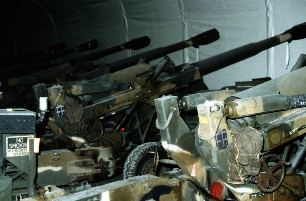 M-198 155mm towed howitzers are stored in a prepositioning cave which contains U.S. Marine Corps equipment