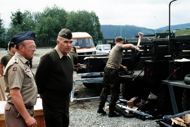 MGEN Henry C. Stackpole III, director plans and policy directorate, U.S. Atlantic Fleet, speaks with a Norwegian officer while overseeing operations as Marines prepare to move equipment to pre-positioning caves for storage