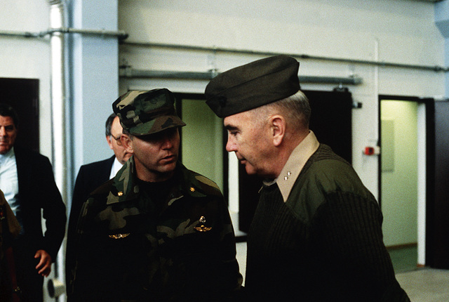 MGEN Henry C. Stackpole III, director, plans and policy directorate, U.S. Atlantic Fleet, is briefed by a Marine officer at an equipment holding facility