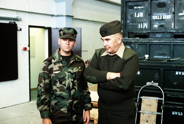 MGEN Henry C. Stackpole III, director plans and policy directorate, U.S. Atlantic Fleet, discusses the storing of equipment in pre-positioning caves with a Marine officer