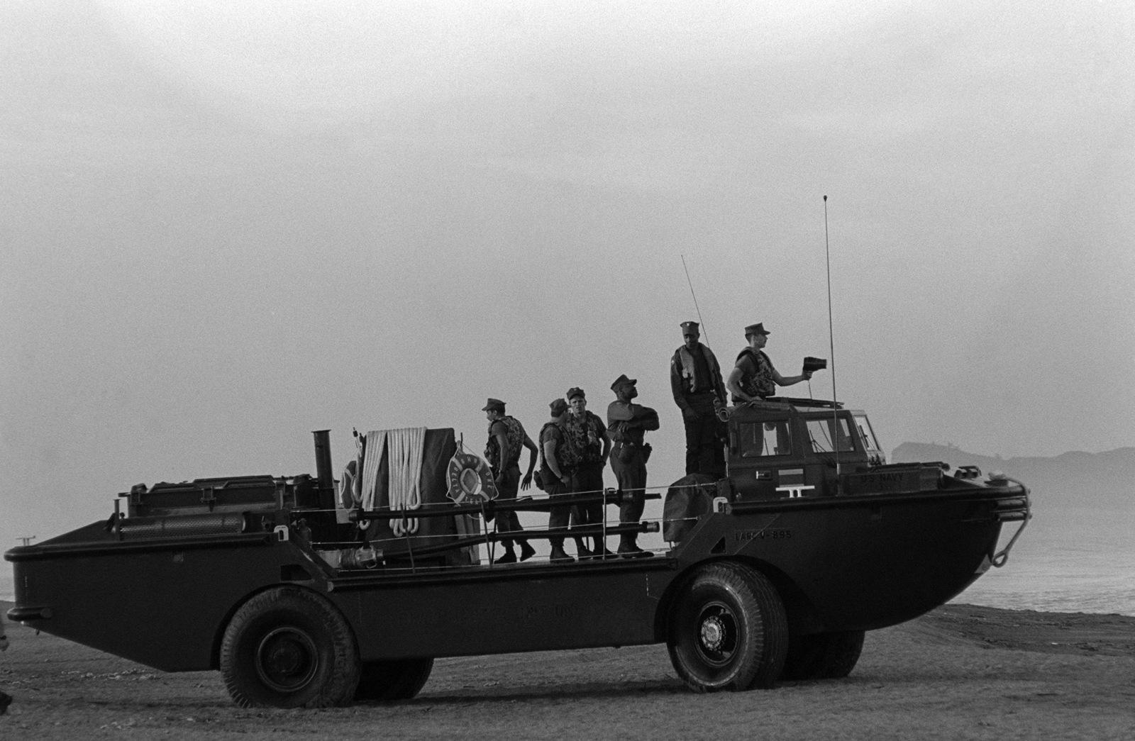 Navy beachmasters come ashore in a LARC-5 amphibious cargo carrier