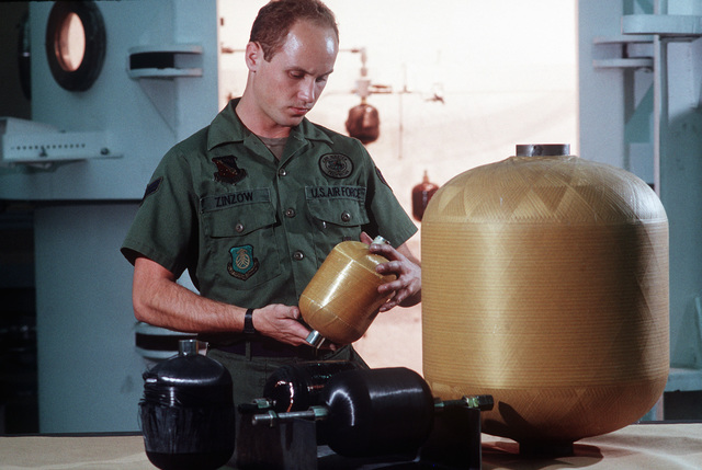 STAFF Sergeant Darryl Zinzow, a composites with the Aerospace Launched Missile Branch of the Air Force Astronautics Laboratory, examines a spool of material