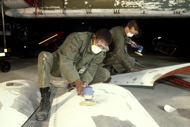 Technicians use sanders to prepare aircraft parts for painting. Aircraft inspections and repairs are made quickly and more efficiently due to the implementation of the Strategic Air Command's Readiness Oriented Logistics System, a program which consolidat