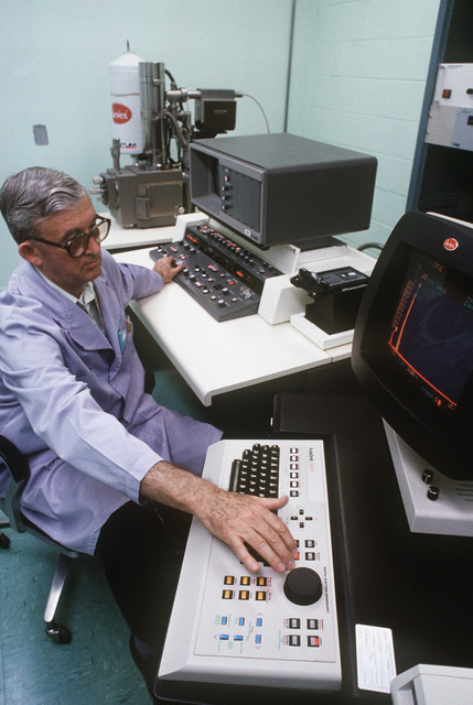 Tom Owens, a civilian physical scientist with the Aerospace Launched Missile Branch of the Air Force Astronautics Laboratory, checks the progress of his analyses at his work station