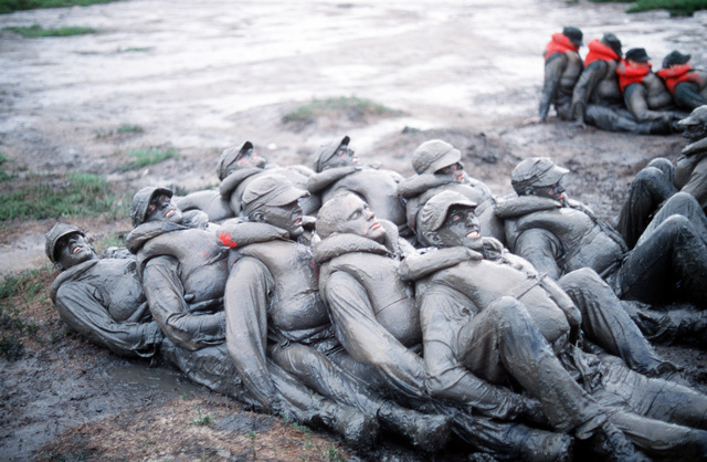 U. S. Navy Basic Underwater Demolition/Sea-Air-Land (BUD/S) trainees participate in a training exercise in the mud