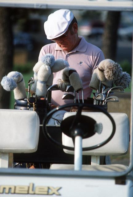 A retiree checks his golf clubs at the base golf course at Naval Amphibious Base, Little Creek, Virginia