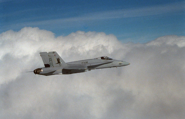 An air-to-air right side view of an F/A-18C Hornet aircraft from Strike Fighter Squadron 82 (VFA-82) conducting the squadron's first operational flight off the coast of Florida.  The Florida based squadron is transitioning from the A-7E Corsair II to the Hornet