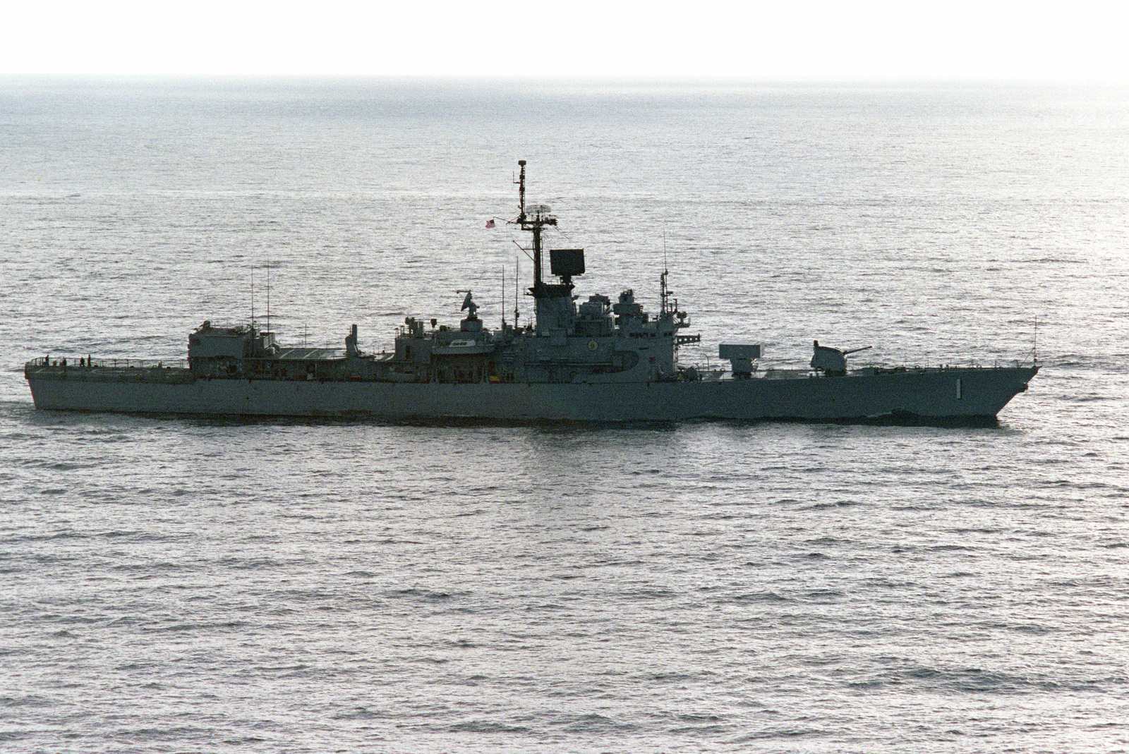 Starboard view of the US Navy's first guided missile frigate, the Brooke Class, USS BROOKE (FFG 1) off the coast of San Clemente Island, California, during a missile exercise