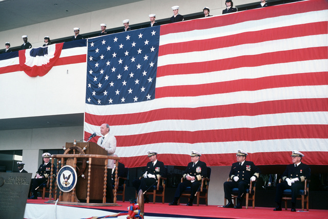 A distinguished guest speaks at the opening of the new Naval Hospital, San Diego.  Seated behind the speaker are, from left to right:  Captain (CAPT) C.A. Wesolowski, commander, Naval Hospital San Diego; Dr. W. E Mayer, assistant secretary of defense for health affairs; Rear Admiral (RADM) (upper half) H.J.T. Sears, commander, Naval Medical Command, Southwest Region; Vice Admiral J.A. Zimble, surgeon general, US Navy; Rear Admiral (RADM) (upper half) (B.F. Montoya, commander, Naval Facilities Engineering Command; and Chaplain Captain (CAPT) Kenneth F. Kieffer