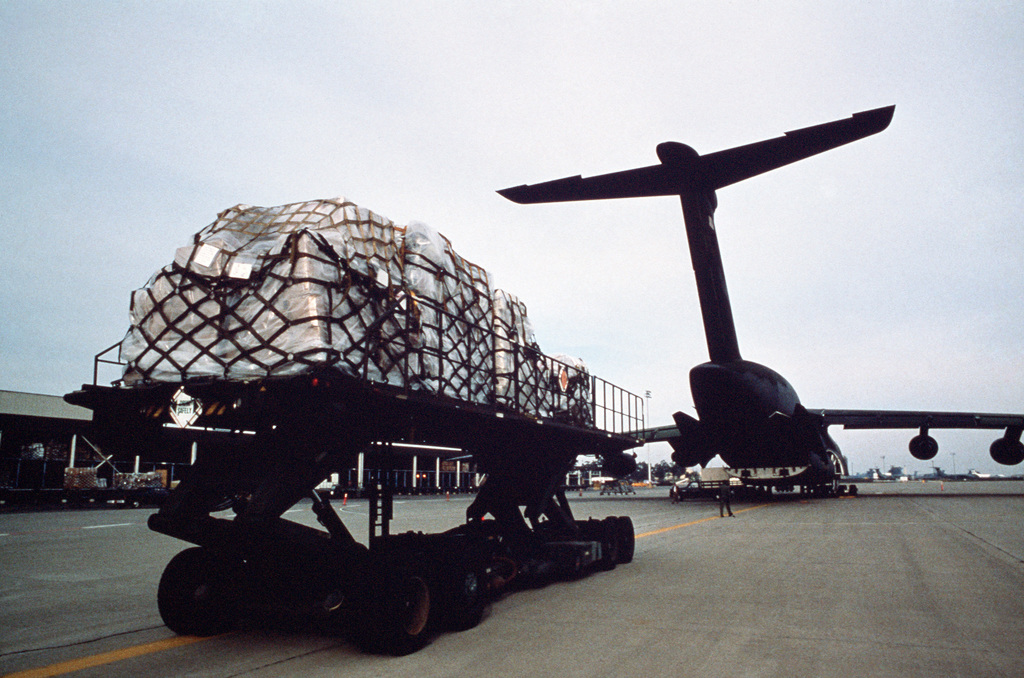 A K-loader moves pallets of medical supplies toward a 60th Military Airlift Wing C-5 Galaxy aircraft for transport to Philippine hospitals. The gathering of the supplies was coordinated by Americare Foundation