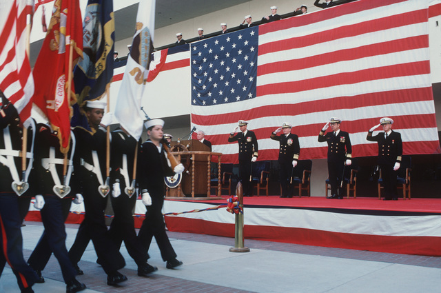 Distinguished guests and naval officers honor the flag as the color guard marches by during the opening of the new Naval Hospital, San Diego.  Guests and officers include, from left to right:  Dr. W.E. Mayer, assistant secretary of defense for health affairs; Rear Admiral (RADM) (upper half) H.J.T. Sears, commander, Naval Medical Command, Southwest Region; Vice Admiral (VADM) J.A. Zimble, surgeon general, US Navy; Rear Admiral (RADM) (upper half) B.F. Montoya, commander, Naval Facilities Engineering Command; and Chaplain Captain (CAPT) Kenneth F. Kieffer