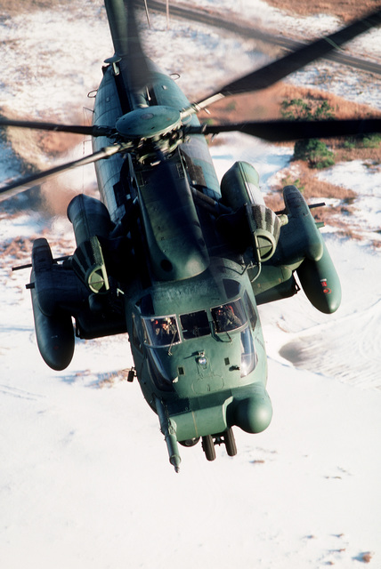 An MH-53H Pave Low III helicopter flies over the coastline