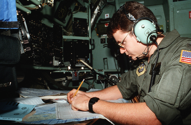 First Lieutenant (1LT) Mark Parker, navigator, 95th Tactical Airlift Squadron, calculates the time and distance to St. Lucia, Virgin Islands.  His squardron is using C-130 Hercules aircraft to transport supplies to missions in the Caribbean and South Amer