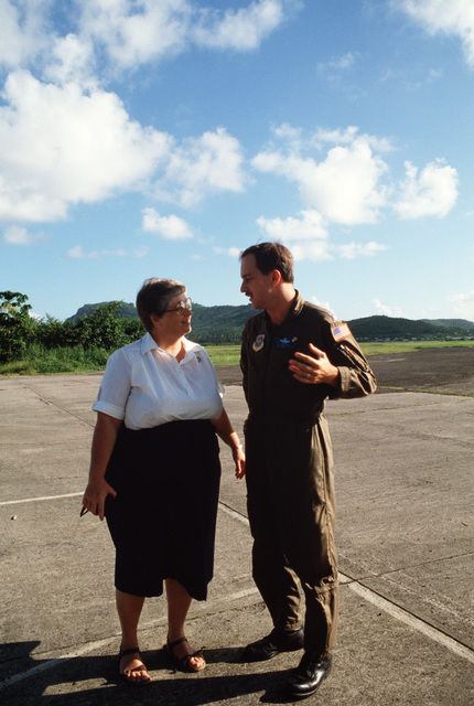 Major (MAJ) Ben Pieczynski, operations officer, 95th Tactical Airlift Squadron, speaks with Sister Sharee Hurtgen, St. Jude Hospital administrator.  The squadron is using C-130 Hercules aircraft to deliver supplies to hospital and other missions in the Ca