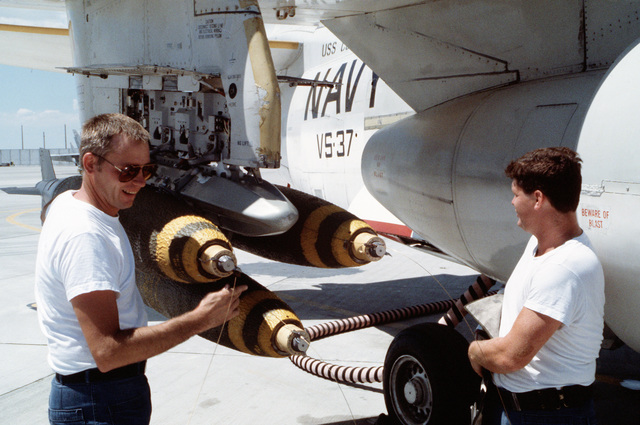 Ordnancemen attach arming wires to the fuses of Mark 82 500-pound bombs on an S-3A Viking aircraft from Air Anti-submarine Sqadron 37 (VS-37) during Exercise GALLANT EAGLE 88