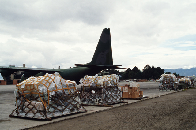 Pallets of supplies sit on the flight line after being offloaded from a 95th Tactical Airlift Squadron C-130 Hercules aircraft.  The squadron is delivering supplies to missions in the Caribbean and South America