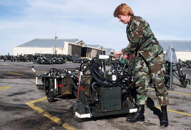 SRA Kara Lachance of the 37th Equipment Maintenance Squadron checks a hose coupling on a compressor in the aircraft ground equipment yard