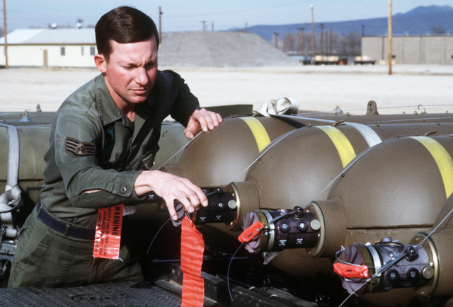 SSGT Robert Bailey of the 37th Equipment Maintenance Squadron checks the fuse on a CBU-58 cluster bomb