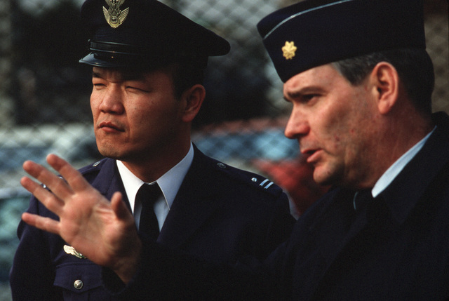 Major (MAJ) James L. McKee, director of logistics plans, 5th Air Force, explains procedures to a visiting Japanese officer during the 475th Air Base Wing mobility Exercise BEVERLY MORNING 88-2