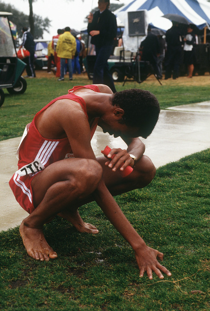 Abdel Razaq of Qatar catches his breath after competing in the five kilometer race during the 1988 Conseil International Du Sport Militaire's Cross Country Championship (CISM)