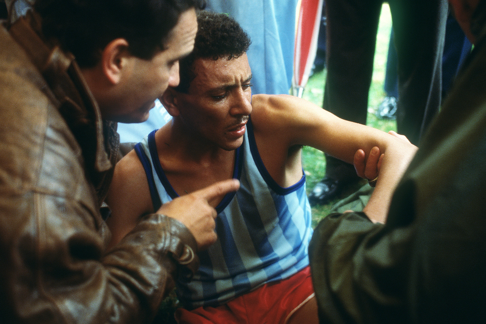 An Egyptian runner receives medical attention after injuring his arm in the five kilometer race during the 1988 Conseil International Du Sport Militaire's Cross Country Championship (CISM)
