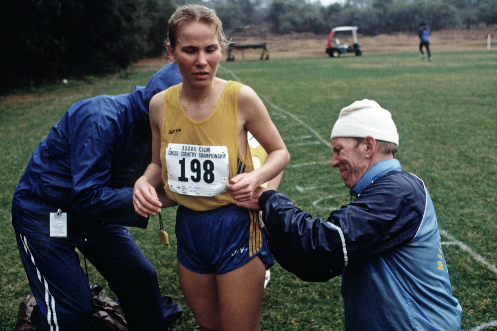 Asa Jonson of Sweden is assisted with the application of her numerals before her race during the 1988 Conseil International Du Sport Militaire's Cross Country Championship (CISM)