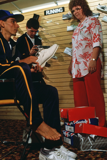 Brazilian runner Laurenio Bezerra is fitted for shoes at the base exchange while here participating in the 1988 Conseil International Du Sport Militaire's Cross Country Championship (CISM)