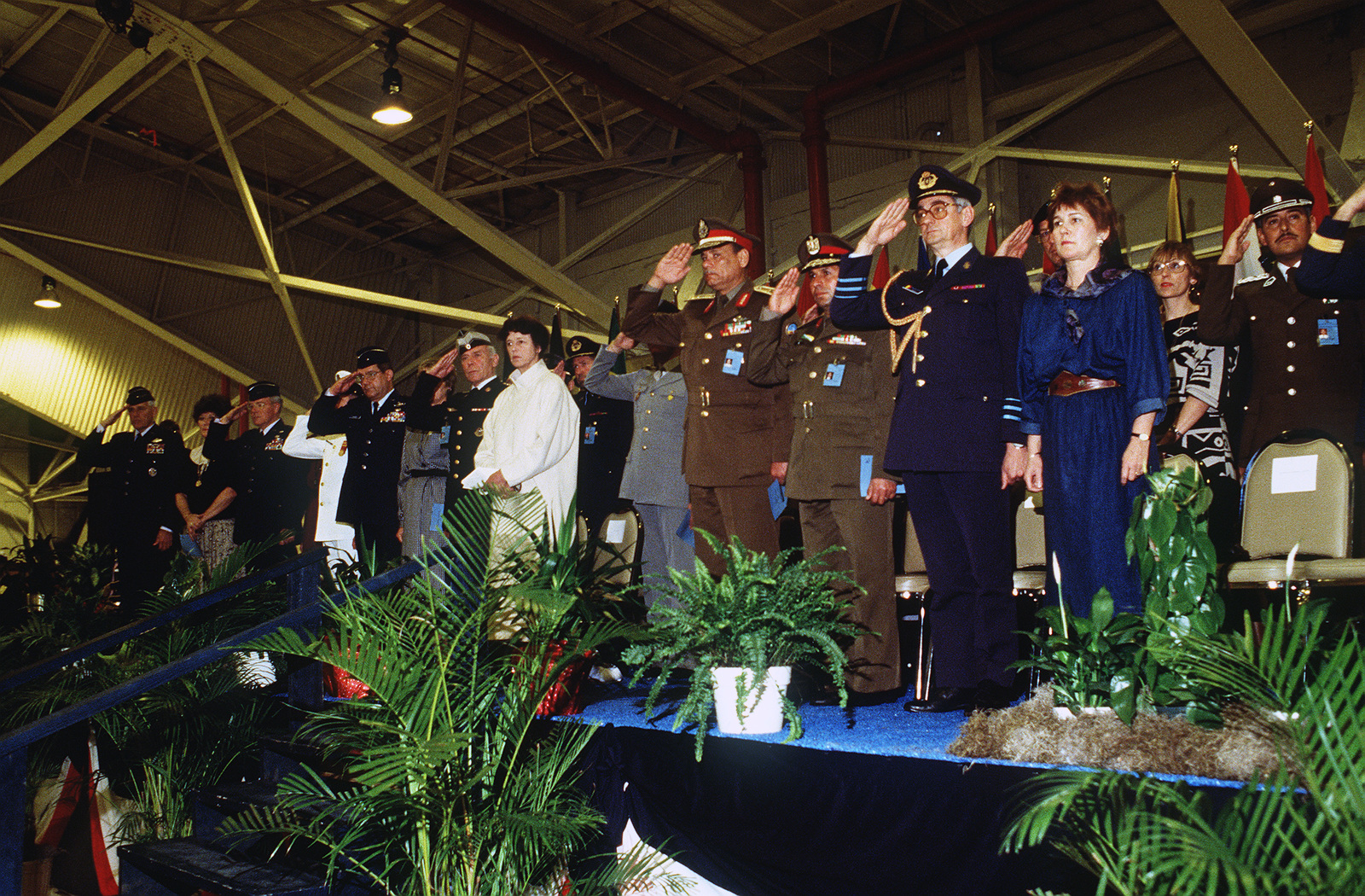 Honored guests render a salute during the closing ceremony of the 1988 Conseil International Du Sport Militaire's Cross Country Championship (CISM)