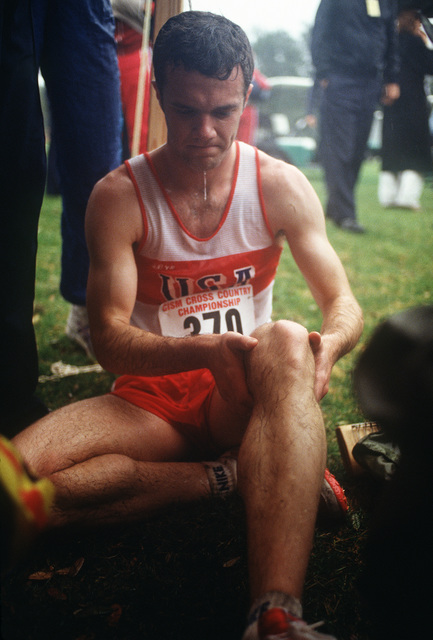 James Foley of the United States massages his legs after the five kilometer race during the 1988 Conseil International Du Sport Militaire's Cross Country Championship (CISM)
