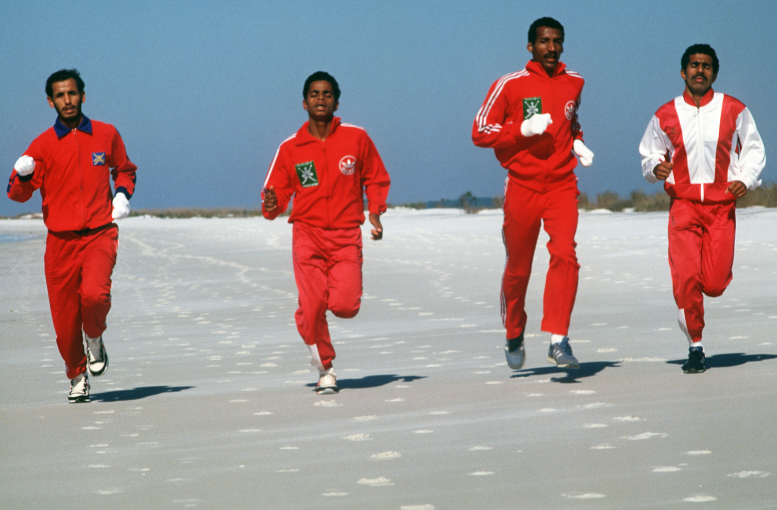 Members of the Oman cross country team jog along the beach during training for the 1988 Conseil International Du Sport Militaire's Cross Country Championship (CISM)