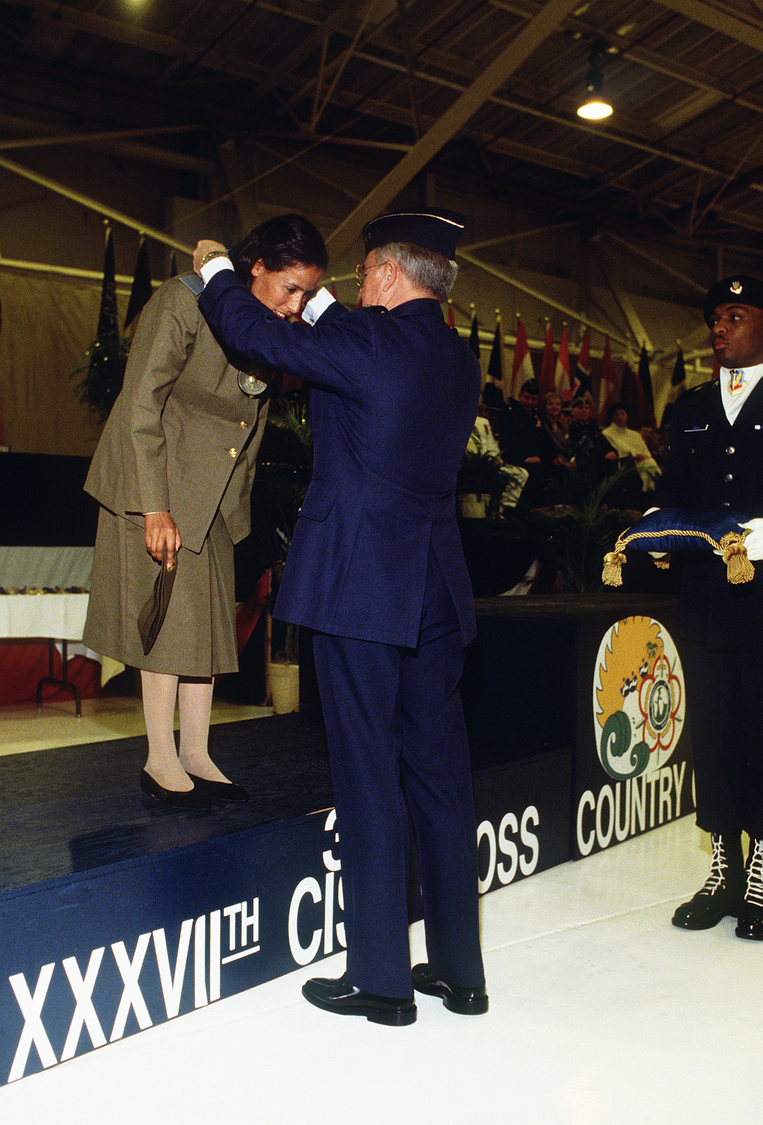 R'kiya Maraqui of Morocco, third place finisher in the women's five kilometer race, receives her bronze medal during the closing ceremony of the 1988 Conseil International Du Sport Militaire's Cross Country Championship (CISM)