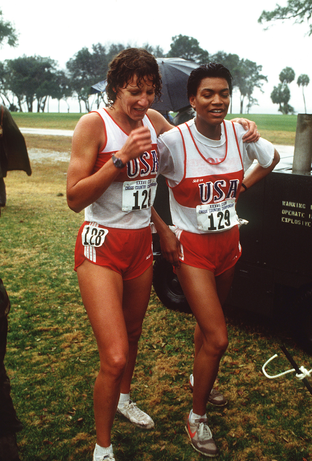 Wanda Howlett, US Army, left, and Lauretta Miller, US Marine Corps, warm down after running their race in the 1988 Conseil International Du Sport Militaire's Cross Country Championship (CISM)