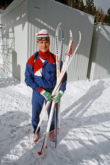 SPECIALIST Fourth Class (SPC) Curtis Schreiner, New York Army National Guard, poses for a picture before participating in the biathlon competition, part of the 1988 Winter Olympics