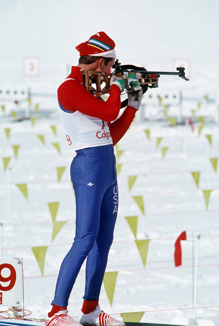 SPECIALIST Fourth Class (SPC) Curtis Schreiner, New York Army National Guard, sights a target from standing position during the biathlon competition, part of the 1988 Winter Olympics
